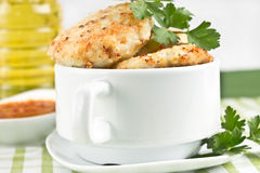 Meat patties in a bowl Stock Photography
