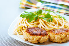 Meat patties and pasta with parsley Stock Images