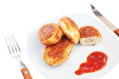 Meat patties on a plate for lunch. Stock Image