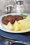 Meat patties with potato stock photo