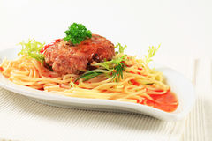 Meat patty and spaghetti Stock Photo