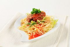 Meat patty with spaghetti Stock Image