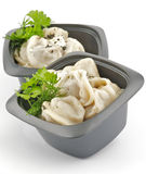 Meat pelmeni with sour cream and greens Stock Image