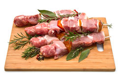 Meat and pepper skewers on a wooden cutting board Stock Images