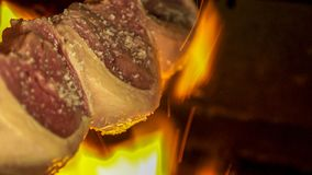 Meat picanha in fire brazil stock photography