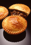 Meat pie. Displayed with meat and gravy showing Royalty Free Stock Photography
