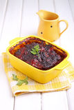 Meat pie baked in a yellow bowl Stock Image