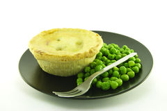 Meat Pie on a Black Plate Stock Image