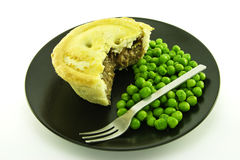 Meat Pie on a Black Plate Stock Photography