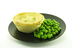 Meat Pie on a Black Plate Stock Images