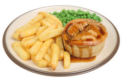 Meat Pie, Chips & Gravy. Individual meat pie with chips peas and gravy Stock Image
