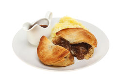 Meat pie and gravy royalty free stock image