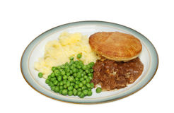 Meat pie. Mashed potato and peas on a plate isolated against white Stock Image