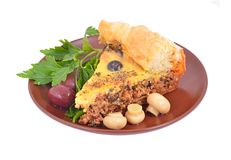 Meat pie with olive on plate Royalty Free Stock Photo
