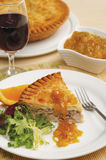 Meat pie with onion and orange jam Stock Images