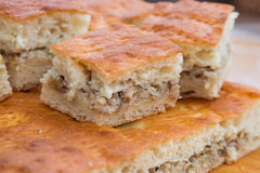 Meat pie. Pie dough. The filling is rice and meat. Side view. Stock Photography