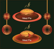 Meat pie on a plateau with Christmas decors. Meat/sweet pie on a plateau with suspended Christmas globes and stars near it, on dark green background Stock Photos