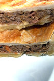 Meat pie slices. The traditonal aussie meat pie with bacon and onion Stock Images