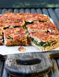 Meat pie with spinach filling Royalty Free Stock Photos