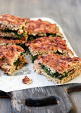 Meat pie with spinach filling Stock Photo