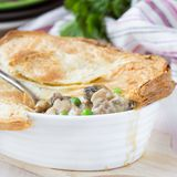 Meat pie with stew of chicken, mushrooms, peas, puff pastry Royalty Free Stock Photo