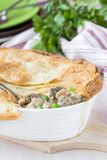 Meat pie with stew of chicken, mushrooms, peas, puff pastry Royalty Free Stock Image