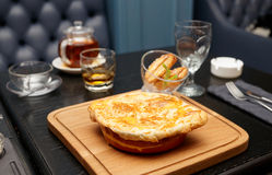 Meat pie on table in pub Royalty Free Stock Image