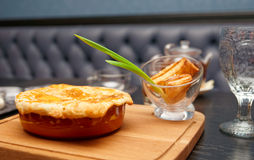 Meat pie on table in pub Royalty Free Stock Images