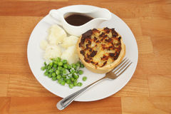 Meat pie and veg stock image