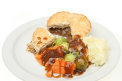 Meat pie and vegetables Stock Photography