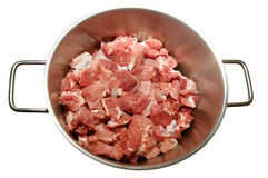 Meat pieces in a pan. Pieces of crude meat in a metal pan. On a white background Stock Photography