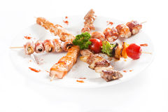 Meat pieces Wrapped in Bacon Royalty Free Stock Photos