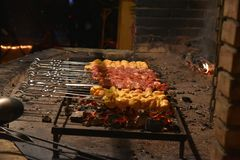Meat pierced with skewers at the stake. Meat pierced with skewers at the roasting in the stake Royalty Free Stock Photo