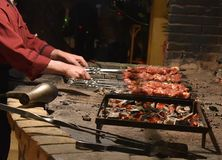 Meat pierced with skewers at the stake. Meat pierced with skewersonon the smoldering coal in the furnace Stock Photos