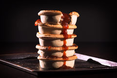 Meat Pies with sauce and high contrast lighting. Royalty Free Stock Photos