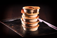 Meat Pies with sauce and high contrast lighting. Stock Photography