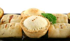 Meat Pies And Sausage Rolls. Delicious home baked snack size meat pies, sausage rolls and quiches royalty free stock images