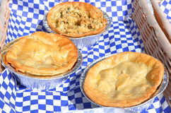 Meat Pies. Savory meat pies for sale in a basket Royalty Free Stock Image