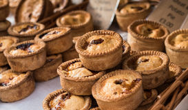 Meat Pies. A selection of delicious meat pies for sale at a market stall Stock Image