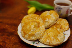 Meat pies with tea Stock Photos