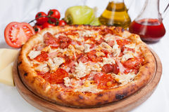 Meat Pizza. Pizza with meat, cheese and tomatoes and oil royalty free stock photography