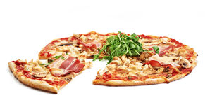 Meat pizza. With slice  on white background Royalty Free Stock Photography