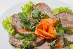 Meat plate with lettuce and parsley Stock Photos