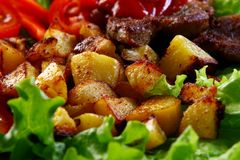 Meat plate with potatoes and souce Royalty Free Stock Photography