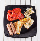 Meat plate with tomatoes Royalty Free Stock Photo