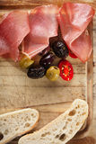 Meat platter of Cured Meat and olives Stock Photography