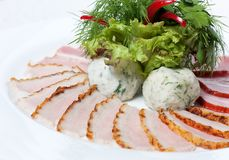 Meat platter with greens Stock Images