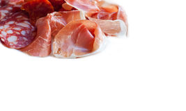 Meat platter: sliced jamon, parma, chorizo sausage, snag. Traditional tapas dish from Spain. white background isolated. copy space Stock Photography