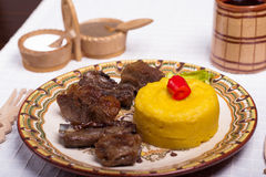 Meat with polenta on the wood with re wine Stock Images