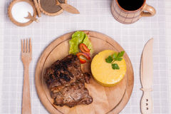 Meat with polenta on the wood with re wine Stock Image